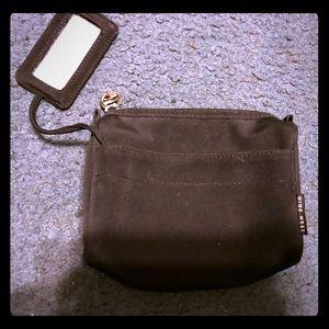 NWOT Small Nine West black makeup bag